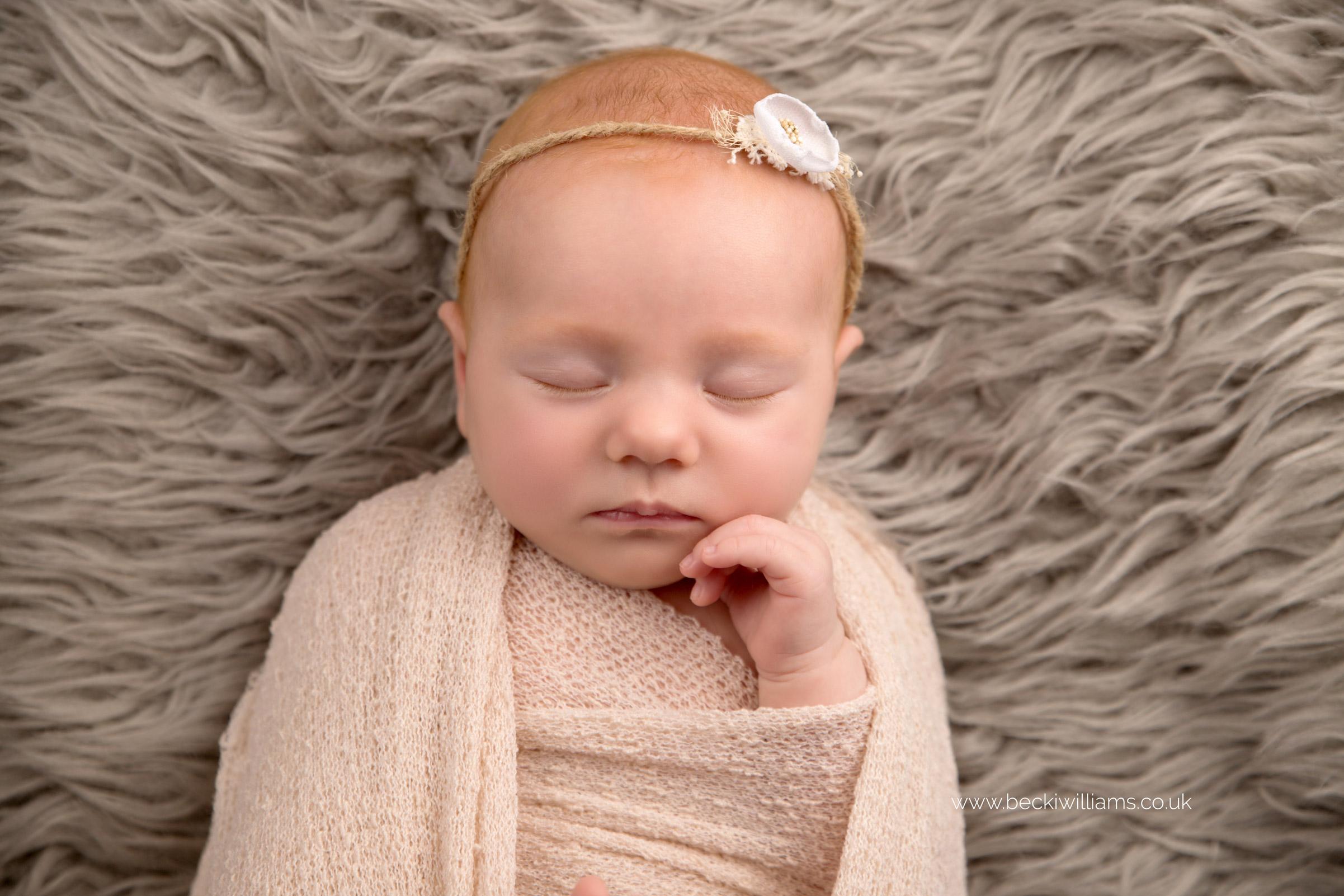 newborn-photographer-in-hertfordshire-wrapped-natural-asleep-neutrals.jpg