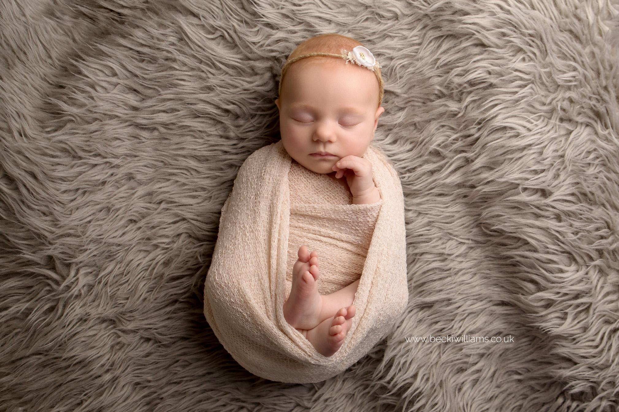 newborn-photographer-in-hertfordshire-wrapped-natural-asleep-girl-ginger.jpg