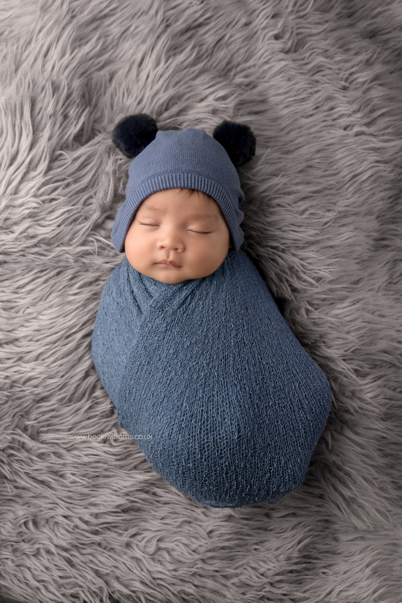 newborn-photography-in-hertfordshire-watford-cute-wrapped-blue-hat.jpg