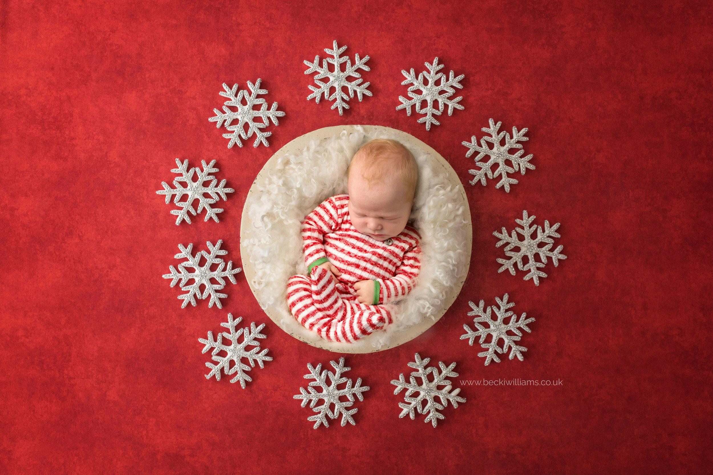 newborn-boy-portraits-hemel-hempstead-christmas-digital-background-red-snow.jpg