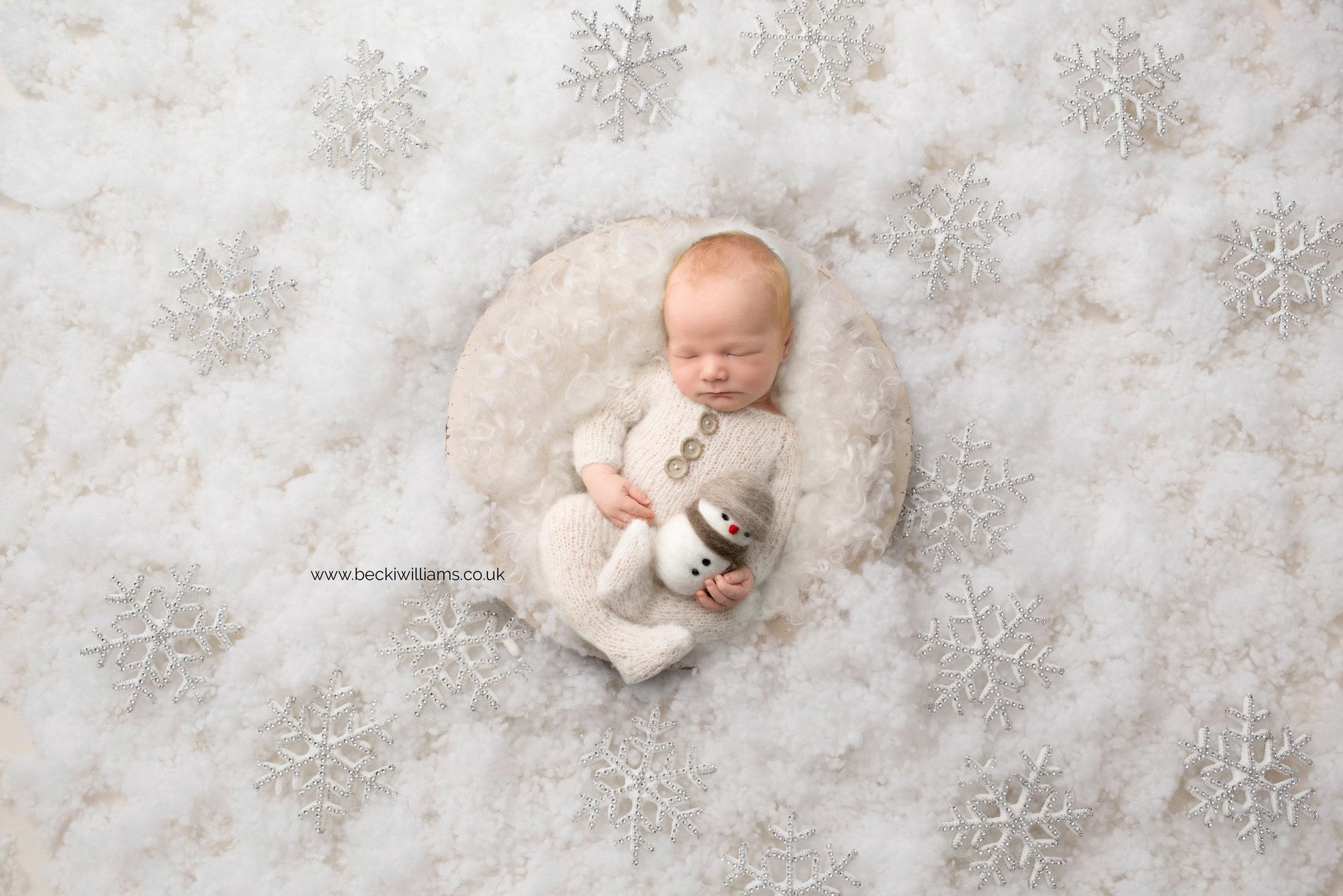 newborn-boy-portraits-hemel-hempstead-christmas-digital-background-snow-flake.jpg