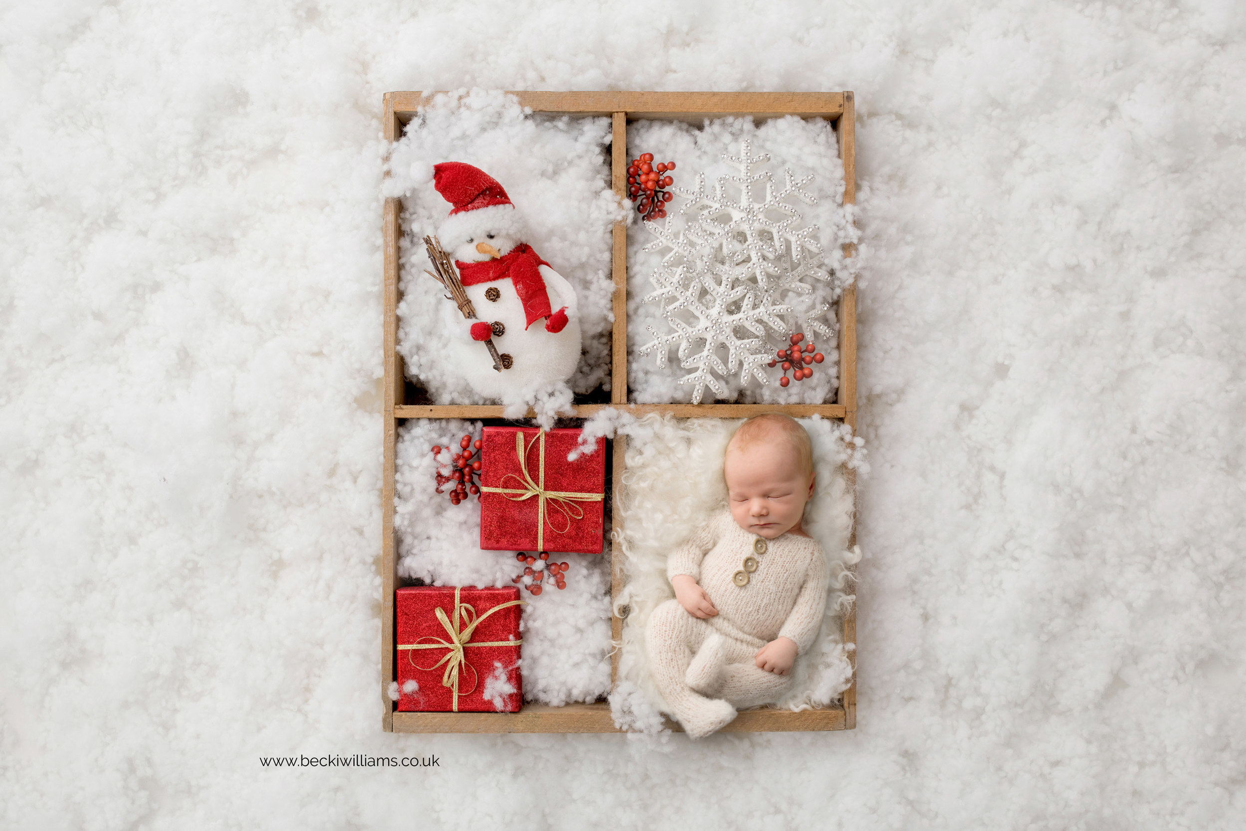 newborn-boy-portraits-hemel-hempstead-christmas-digital-background-snow-presents.jpg