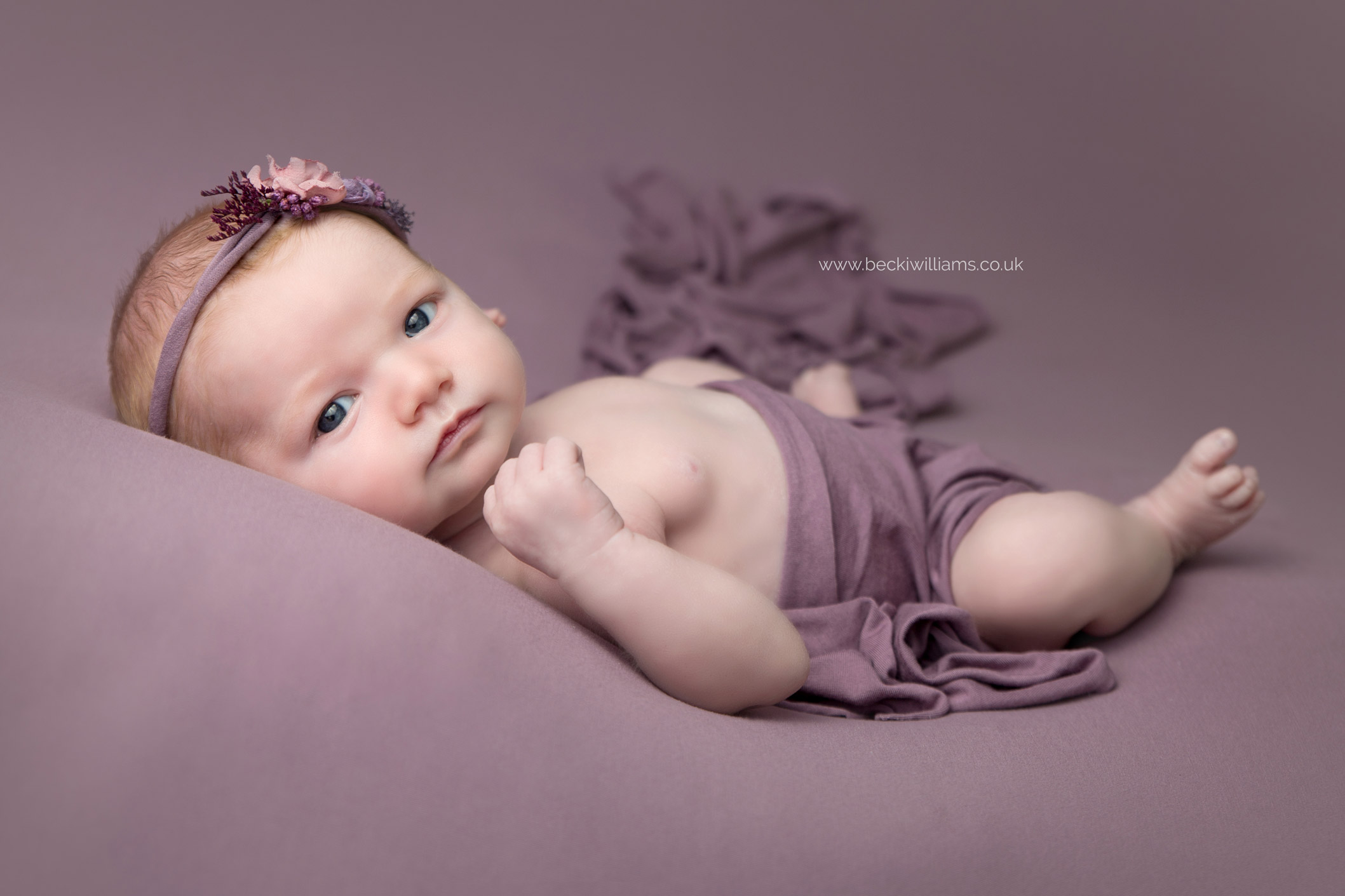 newborn-girl-portraits-hemel-hempstead-purple-awake-cute-headband.jpg