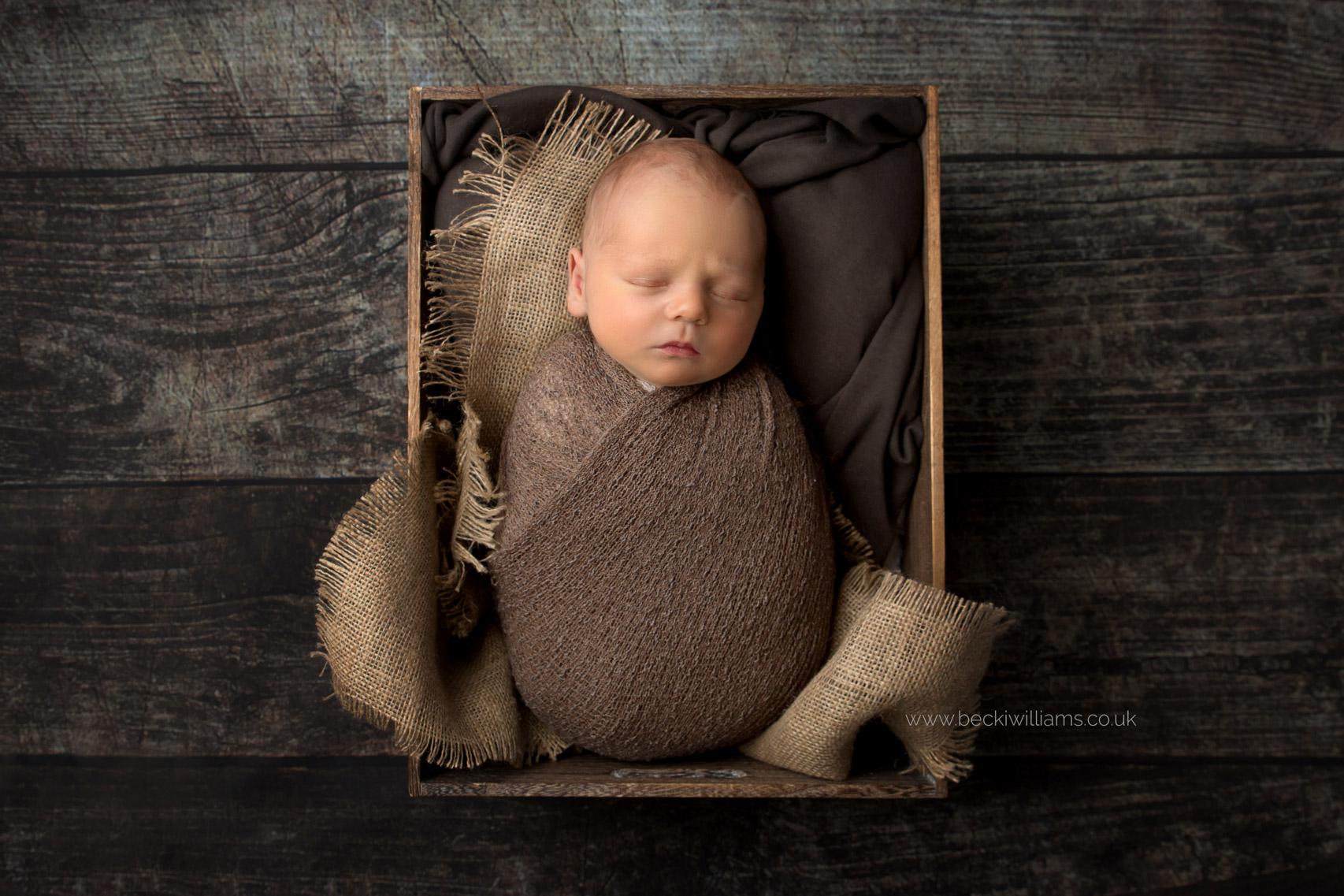 newborn-boy-portraits-hemel-hempstead-brown-crate-asleep.jpg