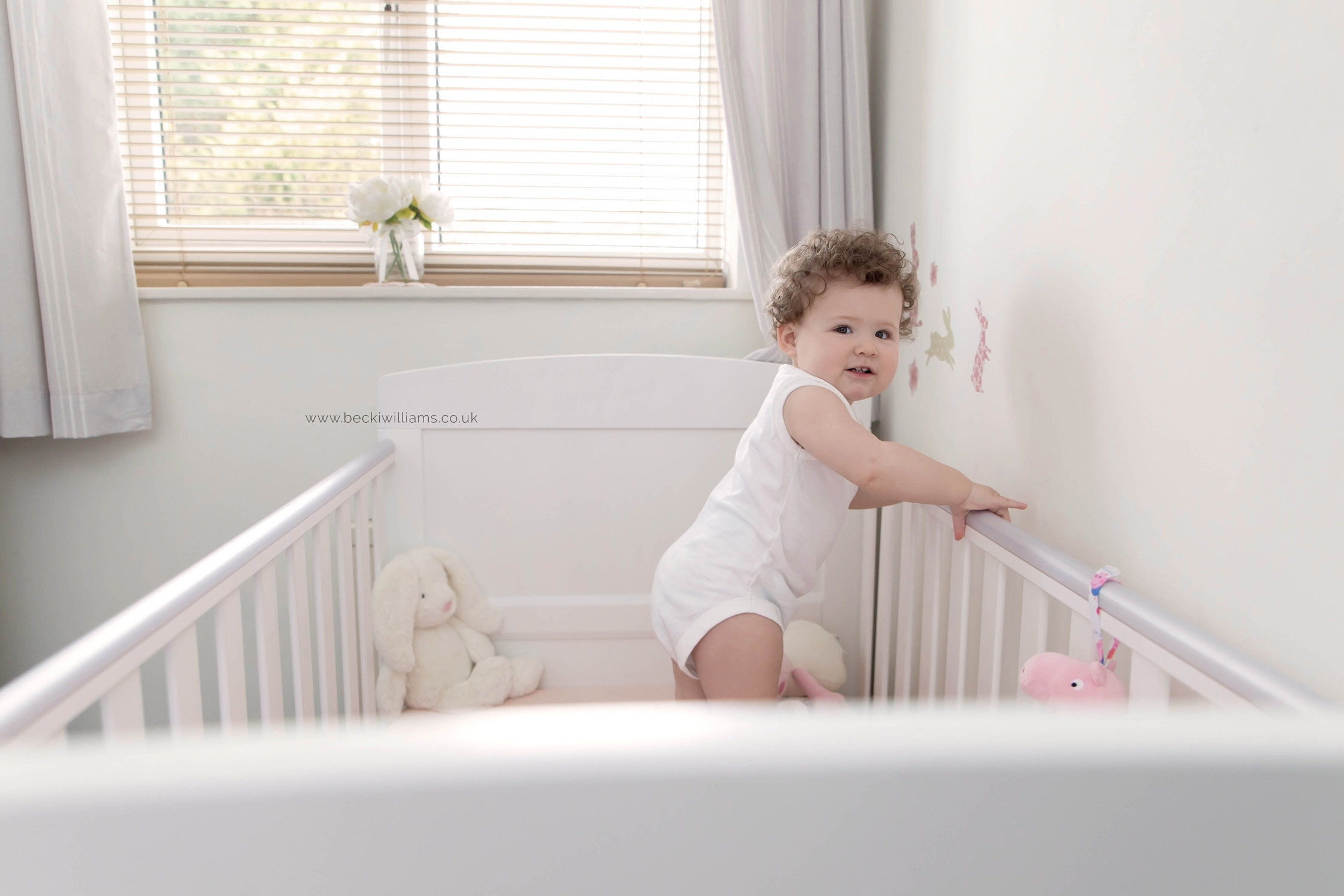 lifestyle-baby-photography-in-your-home-hemel-hempstead-cot-white.jpg