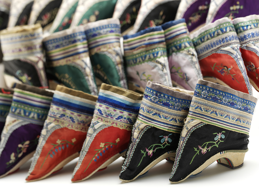Pairs of shoes for bound feet Embroidered silk and cotton over wood China, late 1800s V&A: FE.89, 96, 87, 93, 97, 92, 90:1+2—2002. © Victoria and Albert Museum, London