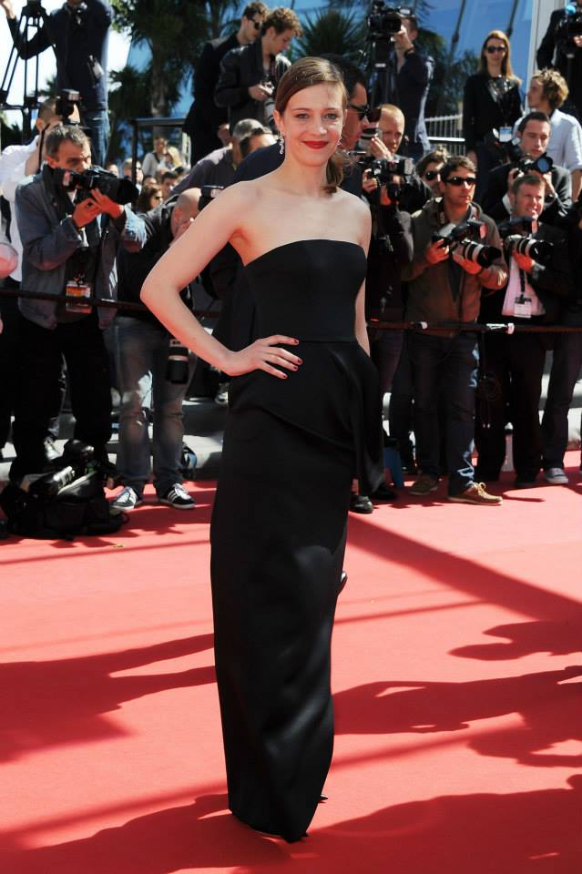 Céline Sallette wore a black satin silk dress and was made up by the Dior Makeup pro Team.