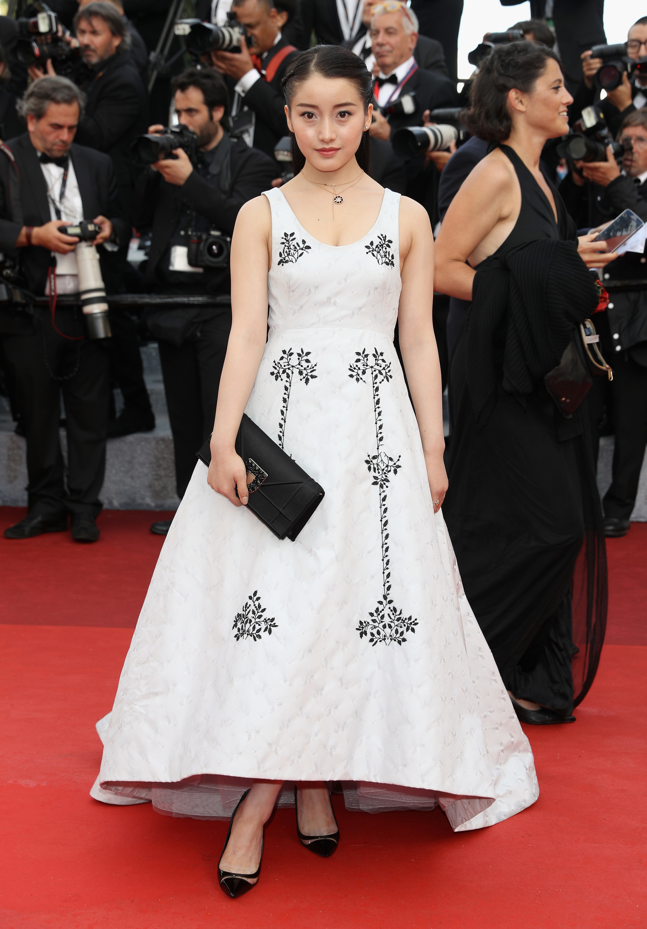 """Yao Xin attends the """"Cafe Society"""" premiere and the Opening Night Gala during the 69th annual Cannes Film Festival at the Palais des Festivals in Dior"""