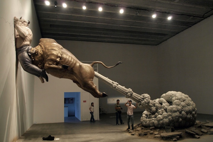 Chen Wenling's   sculpture shows a bull, meant to represent Wall Street, seen ramming the biggest con man of all time, Bernie Madoff, into a wall. The huge cloud coming out of the bull's rear not only refers to the end of a greedy era, but also symbolizes the danger of virtual bubbles in international financial markets.