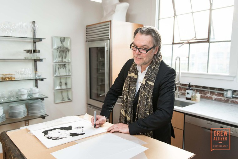 David Downton signing his illustration of Carmen Dell'orefice. Photo: Drew Altizer.  Photographer Avi Mandhavi, Director of Photography Pierre Rieu, Lifestyle contributor JOLIEGAZETTE Anzor Makharadze, Founder JOLIEGAZETTE, Juliet Belkin. Photo: Drew Altizer
