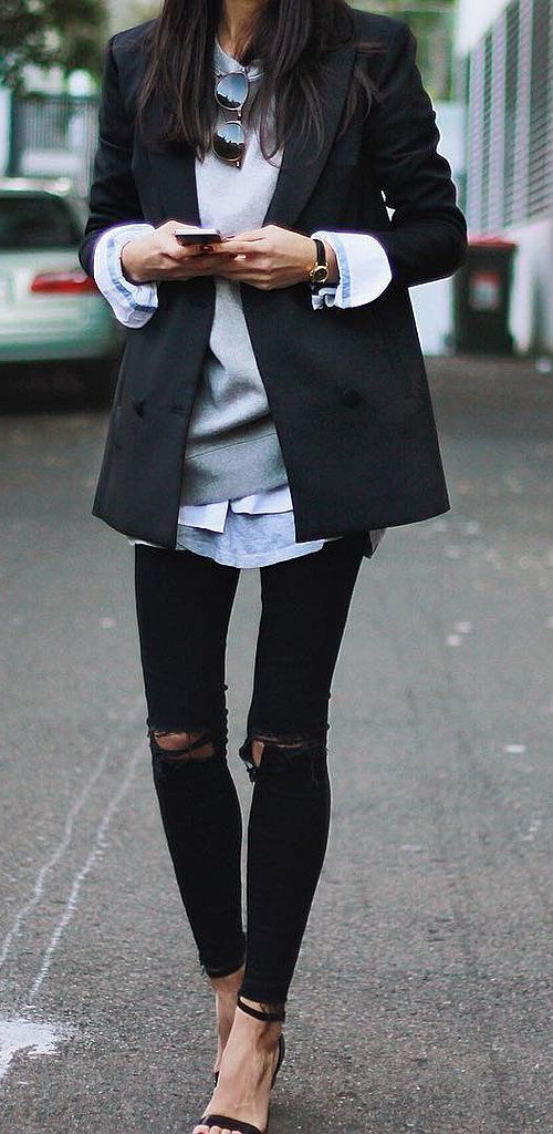 If office allows denim, ripped jeans paired with a sweatshirt layered under a classic blazer is so go.