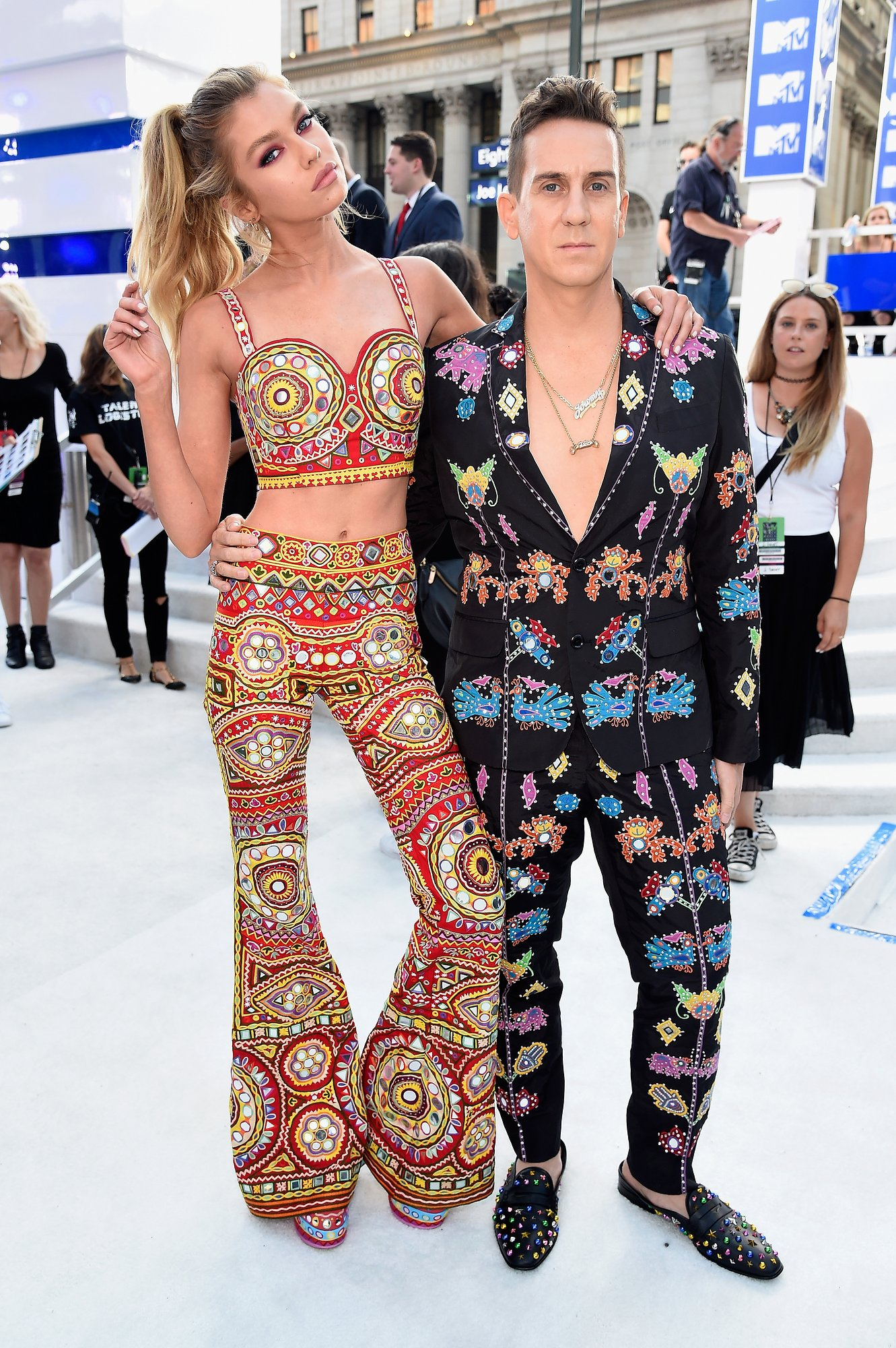 STELLA MAXWELL AND JEREMY SCOOT BOTH IN MOSCHINO