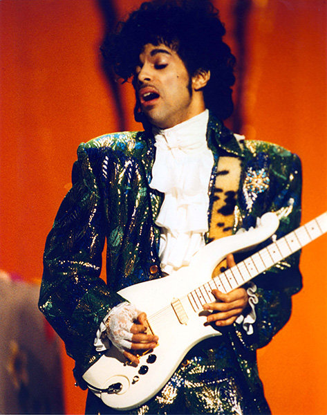 """Prince in 1985  Prince, in his full-on """"Purple Rain"""" mode, shows off his guitar skills at the 1985 AMAs."""