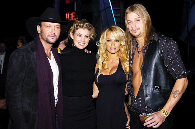Tim, Faith, Pam and Kid Rock in 2003  Tim McGraw, Faith Hill, Pamela Anderson and Kid Rock grinned backstage at the 2003 AMAs.