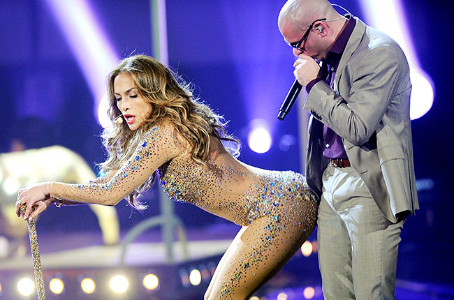 Jennifer Lopez & Pitbull in 2011  Jennifer Lopez, in her skin-tight, skin-colored bodysuit, performs with Pitbull at the 2011 AMAs.