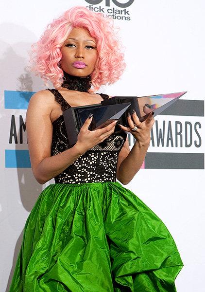 Nicki Minaj in 2011  Nicki Minaj got serious in green at the 2011 AMAs after she won the Best Rap/Hip-Hop Album and Artist Award.