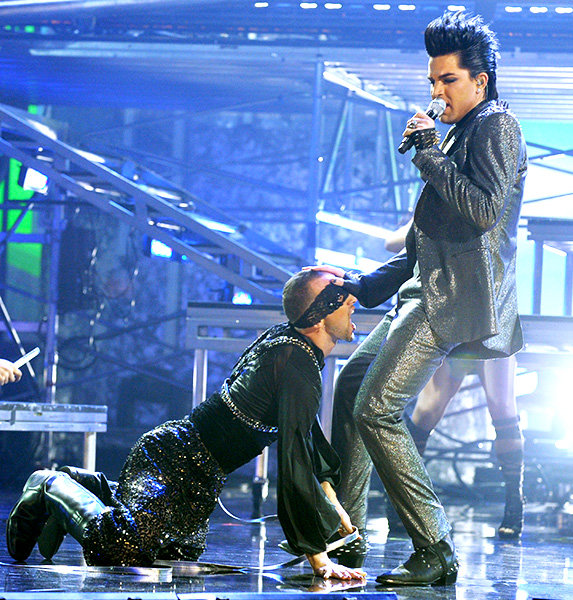 Adam Lambert in 2009  In one of the most memorable AMAs moments ever, Adam Lambert got very up-close and personal with one of his dancers at the 2009 American Music Awards.