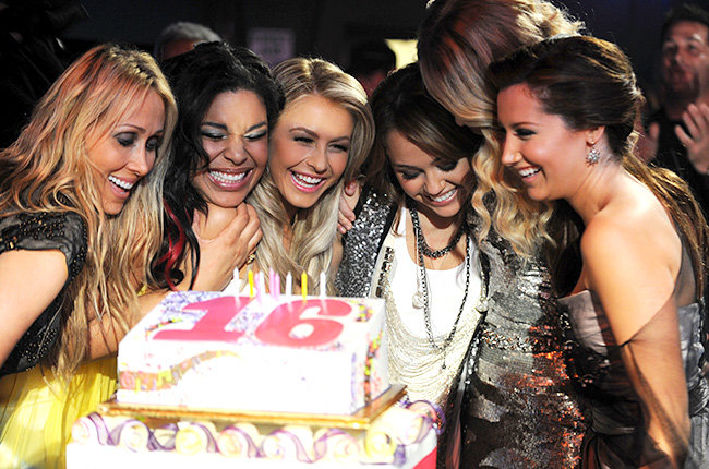 Miley Cyrus and Friends in 2008  Miley Cyrus celebrated a very sweet 16 at the 2008 AMAs alongside the likes of Jordin Sparks, Ashley Tisdale, and Taylor Swift.