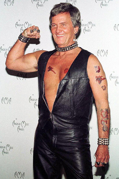 Pat Boone in 1997  Pat Boone donned a surprising leather look at the 1997 AMAs he promoted his metal cover album.