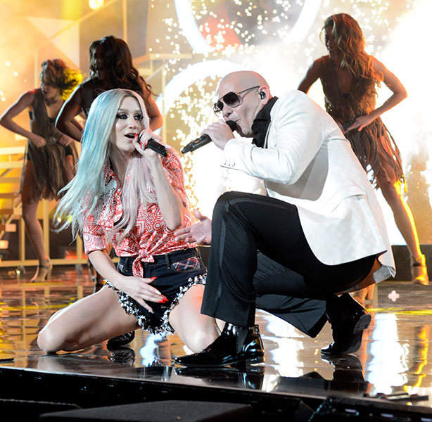 Kesha and Pitbull in 2013  Kesha and Pitbull perform onstage during the 2013 American Music Awards in Los Angeles, CA