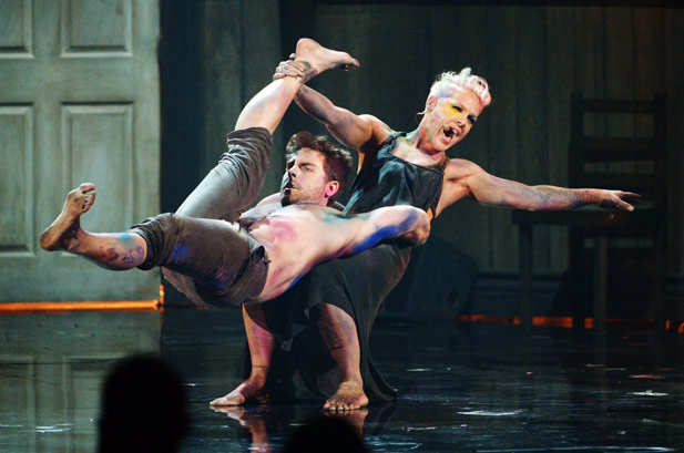 Pink in 2012  Pink shows off her acrobatic skills during her performance at the AMAs in 2012.
