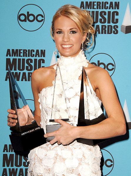 Carrie Underwood With Her Awards in 2007  Carrie Underwood in the press room at the 2007 American Music Awards.