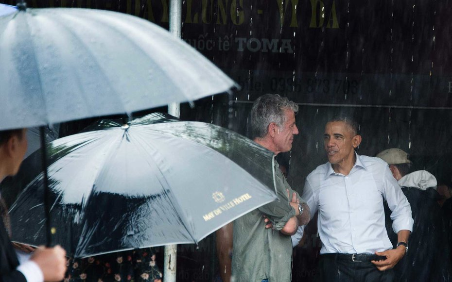 Hanoi, Vietnam  Obama escapes the rain with Anthony Bourdain after meeting for lunch in Hanoi.
