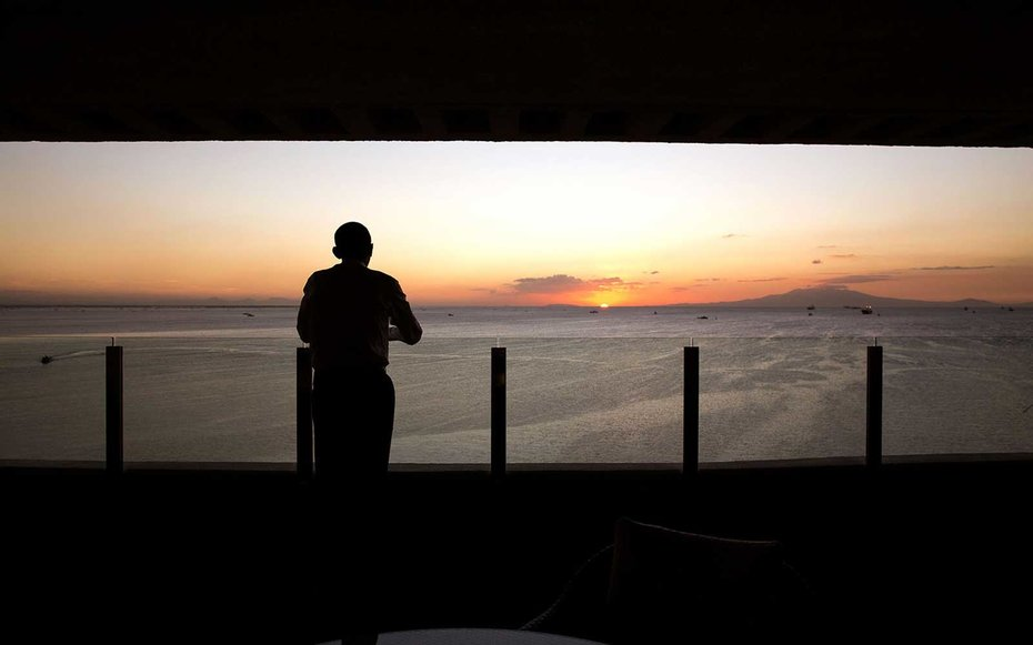 Manila Bay, Philippines  Obama takes a moment to appreciate the stunning scene that is a sunset in Manila Bay.
