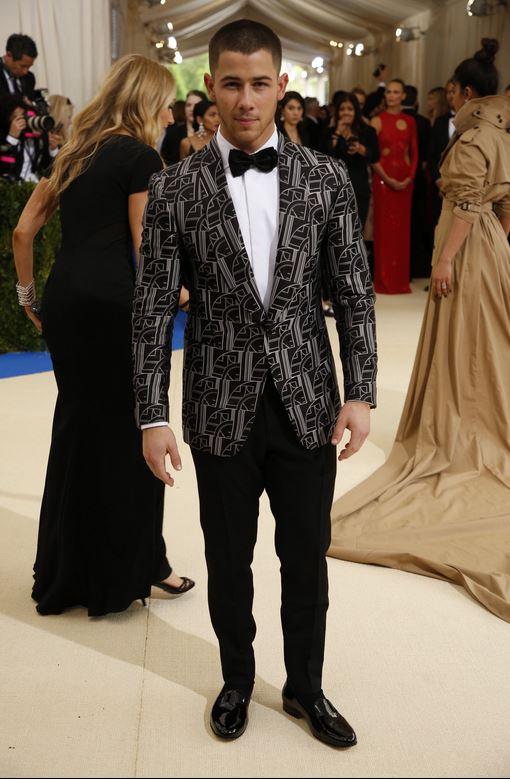 Nick Jonas wearing Ralph Lauren Purple Label. -