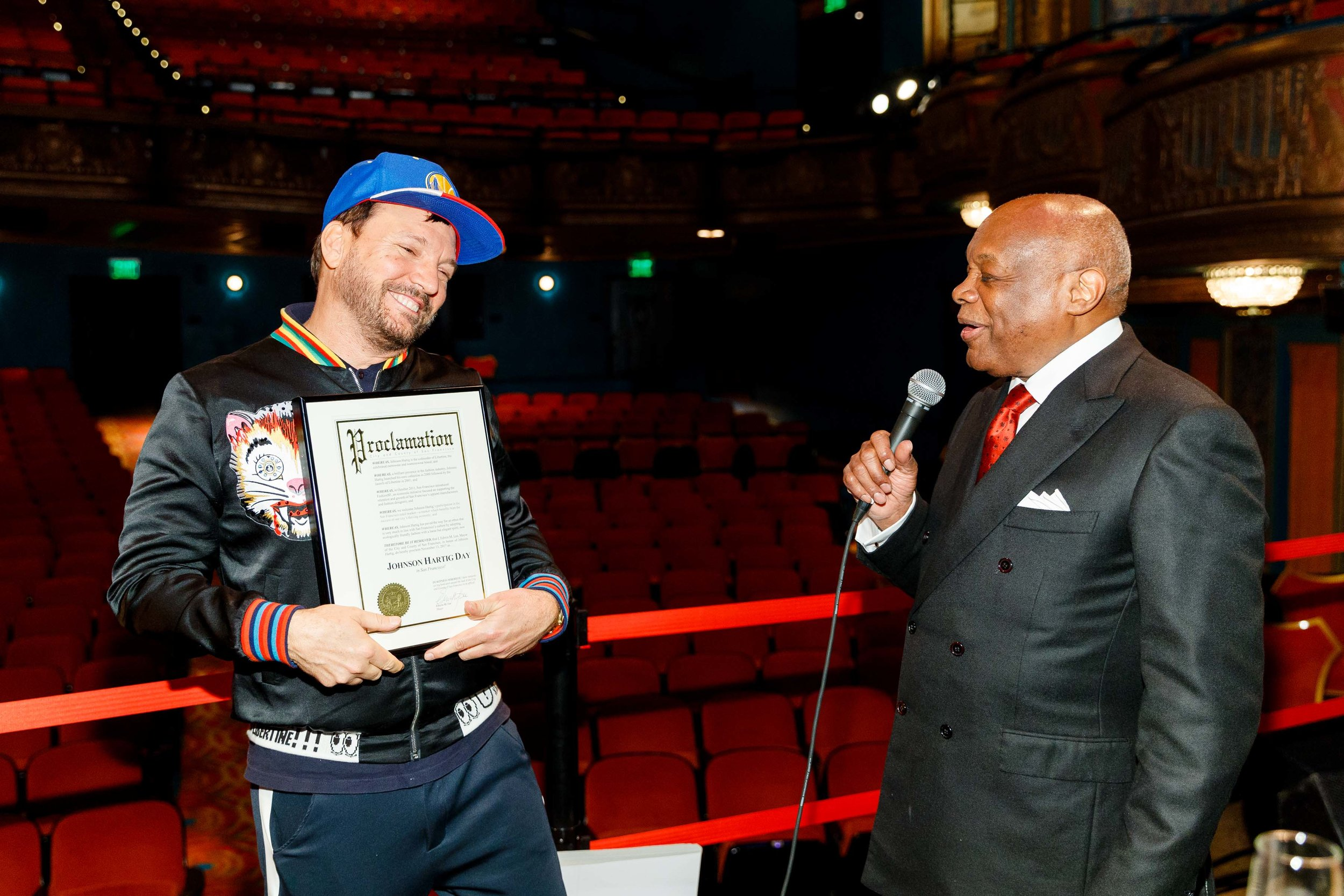 DESIGNER JOHNSON HARTIG ACCEPTING A PROCLAMATION FROM MAYOR WILLIE BROWN