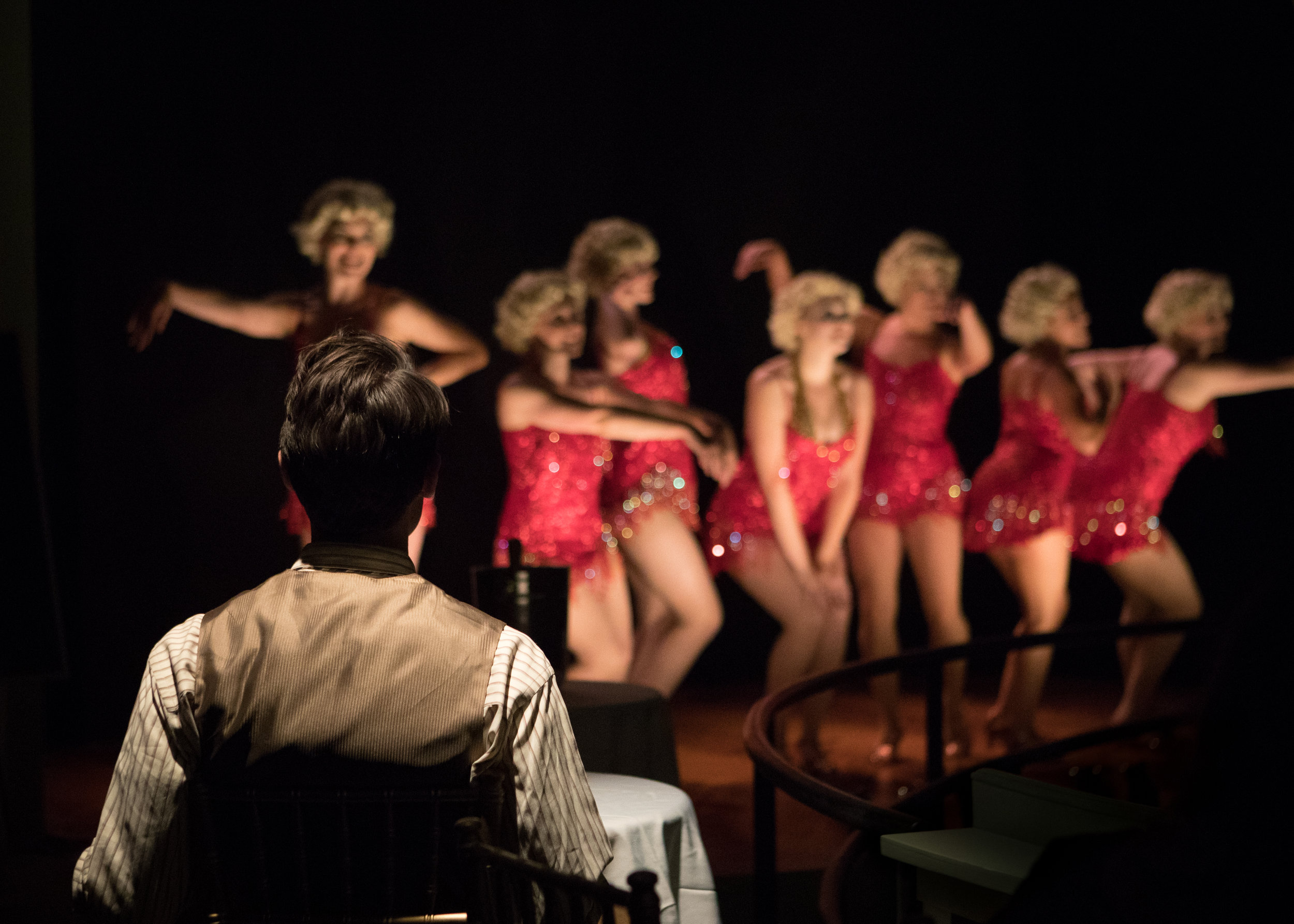 The Speakeasy. A gentleman takes in a show in the cabaret. Photo by Peter Liu.jpg