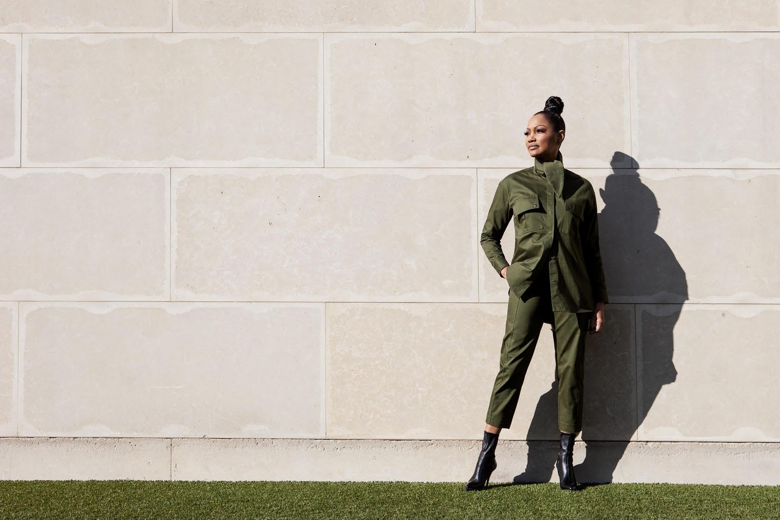 On Garcelle suit by  Mango . Boots by  Gucci.  Sunglasses:  Saint Laurent.