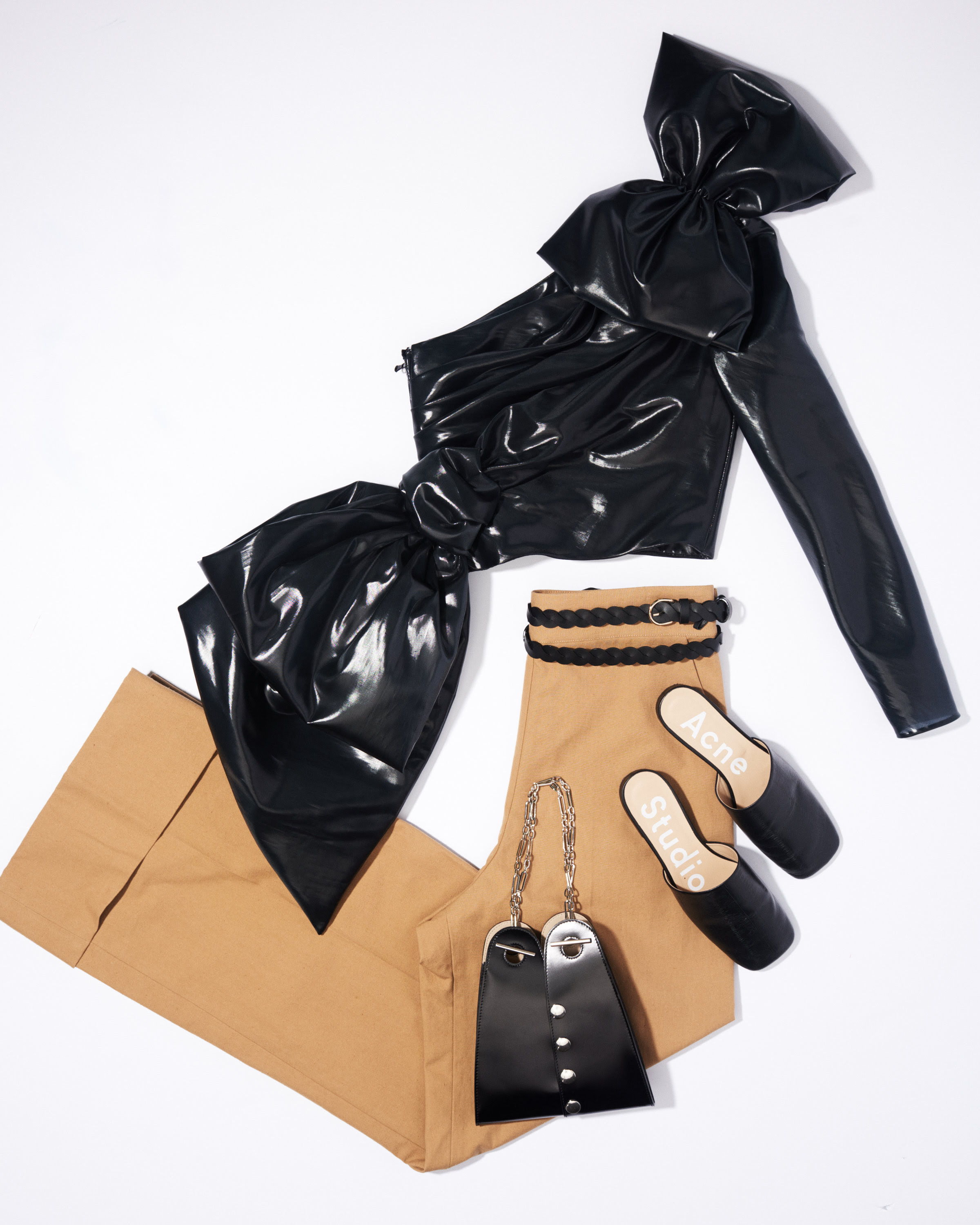 Moschino Bow Top 1,795 | Acne Studios Pants $500 | Lemaire $850 | Nina Ricci Belt $490 | Acne Studios $480