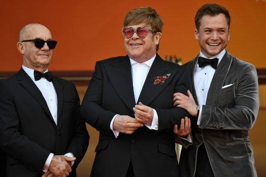 "Songwriter Bernie Taupin, Elton John and Taron Egerton pose as they arrive for the screening of the film ""Rocketman"" at the 72nd edition of the Cannes Film Festival in Cannes.   (Photo: CHRISTOPHE SIMON, AFP/Getty Images)"