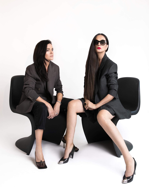 On Giulia vintage blazer, jeans Maison Margiela, shoes Bottega Veneta. On Rushka suit and shoes by Céline, sunglasses Tom Ford. Photo  Lena Di