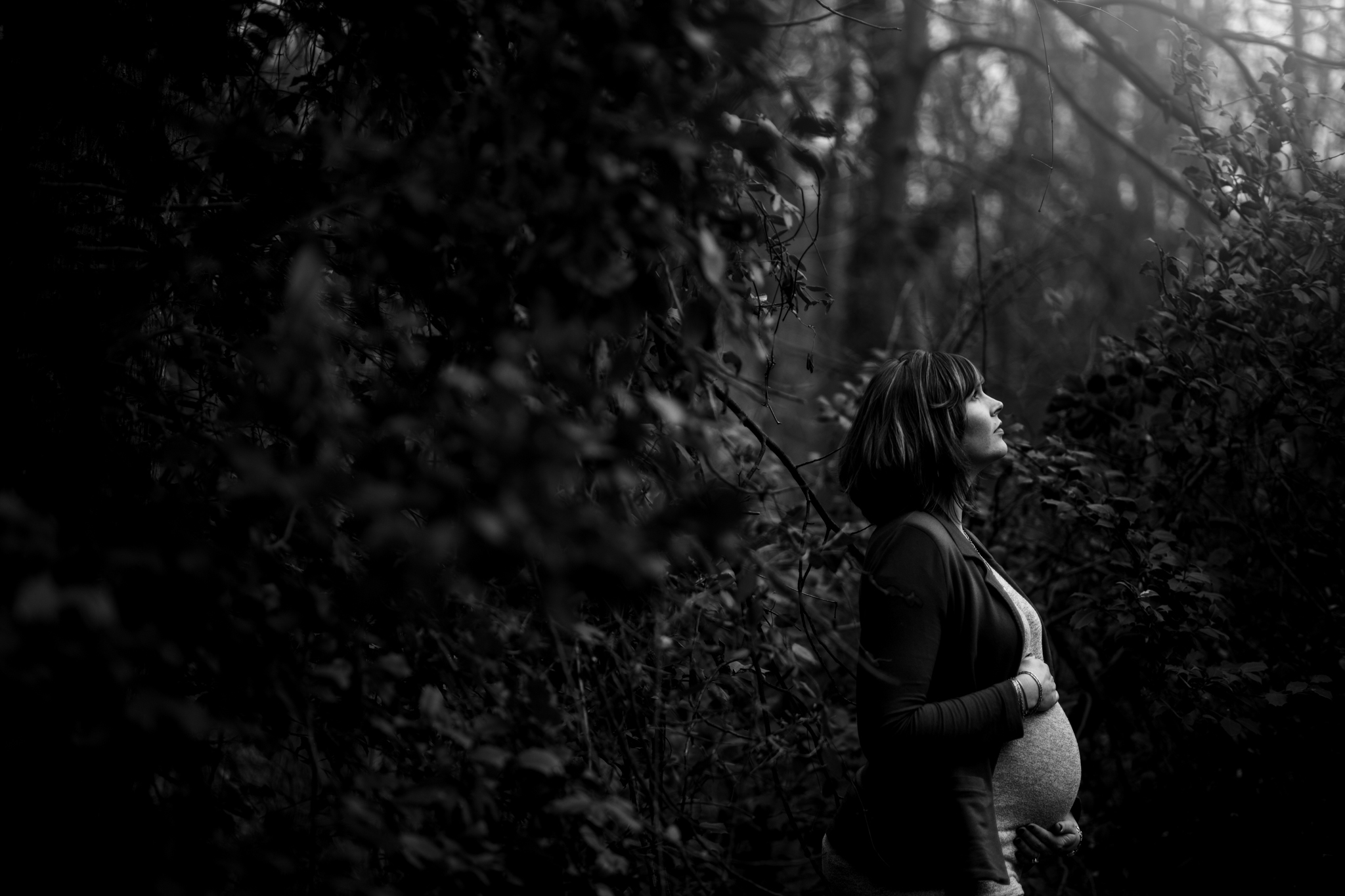 Pregnant woman in woods by Huntsville and Madison Alabama maternity photographer Rachel K Photo