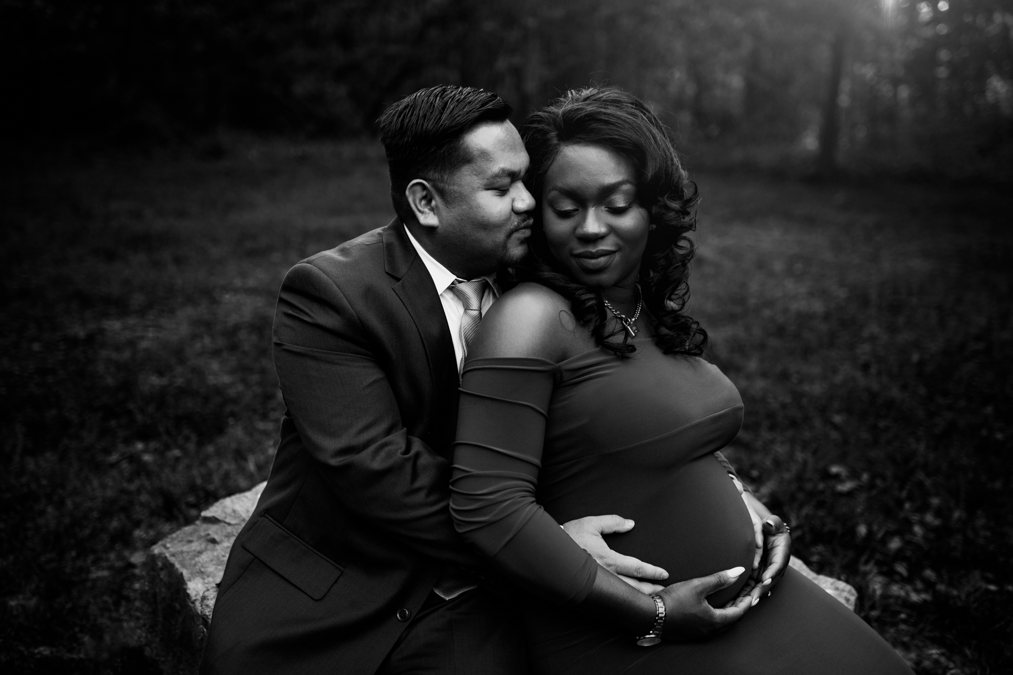 Man snuggles pregnant wife in black and white photo from Huntsville Alabama maternity photographer