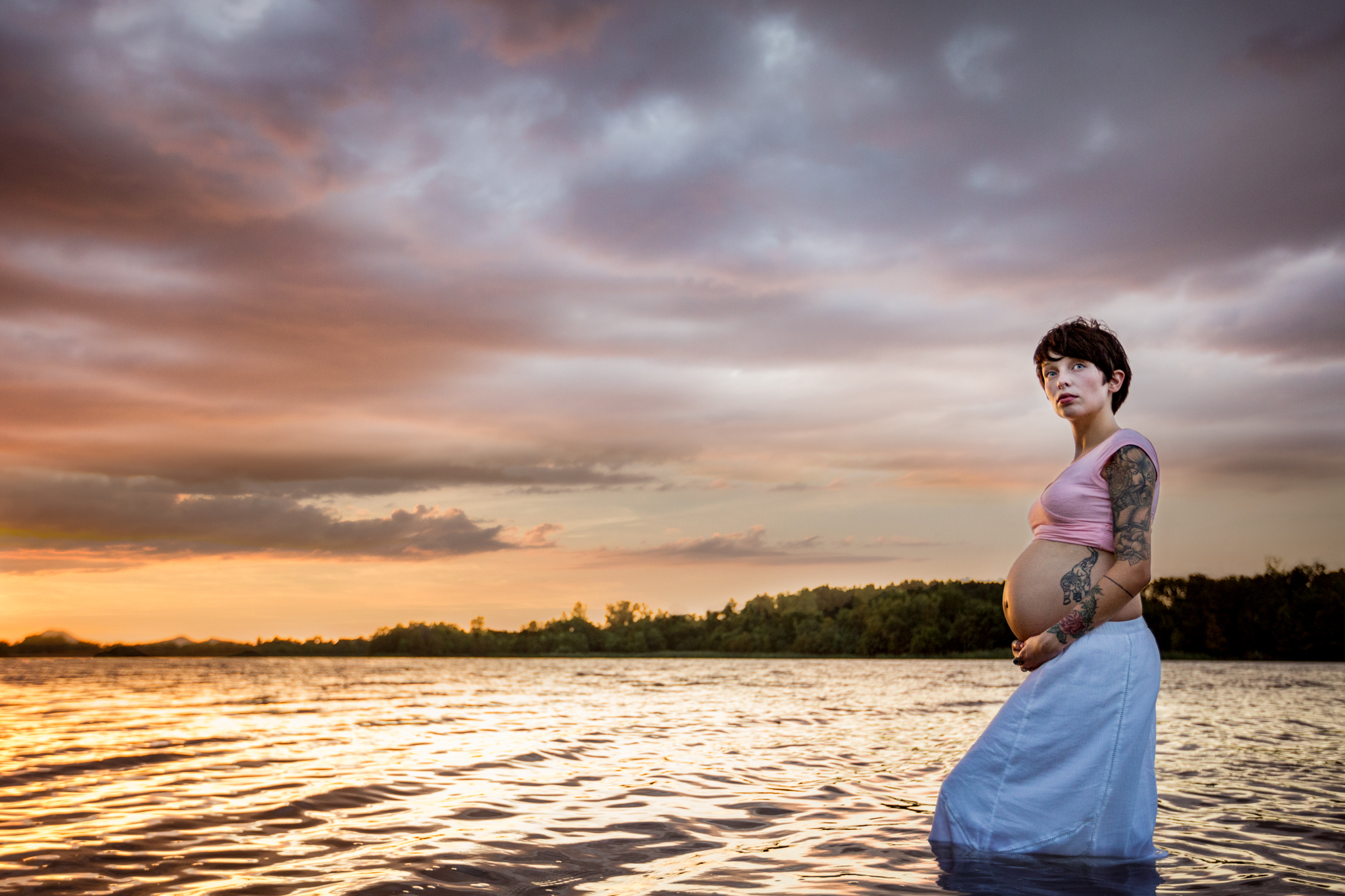 Pregnant woman with bare belly standing in water by Huntsville and Madison Alabama maternity photographer Rachel K Photo