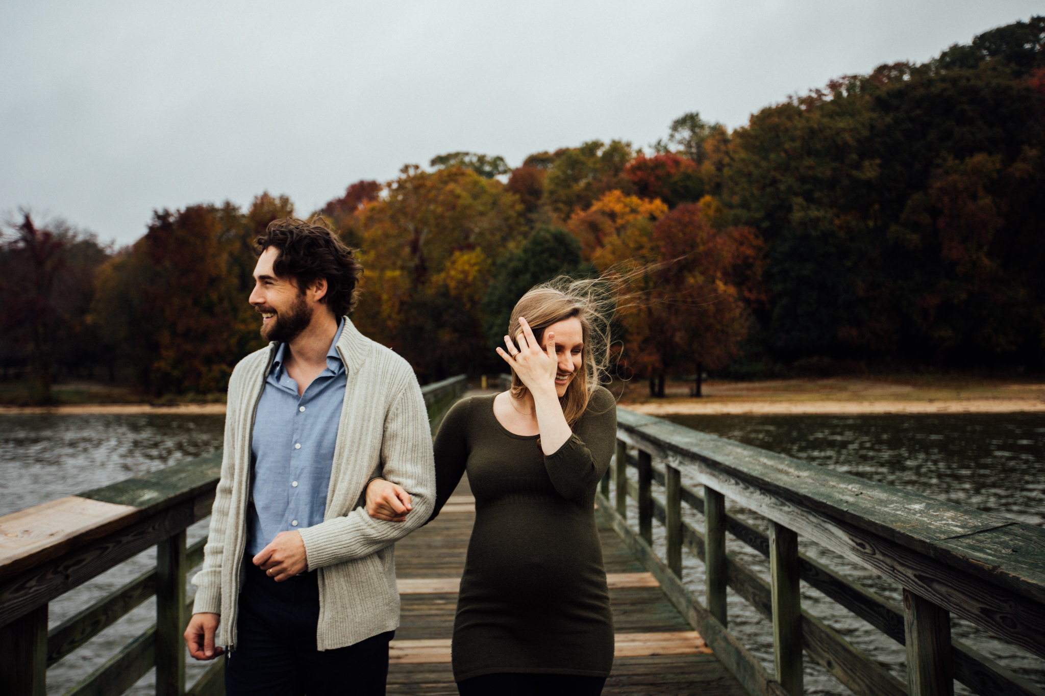 Pregnant woman and man walking down pier by Huntsville and Madison Alabama maternity photographer Rachel K Photo