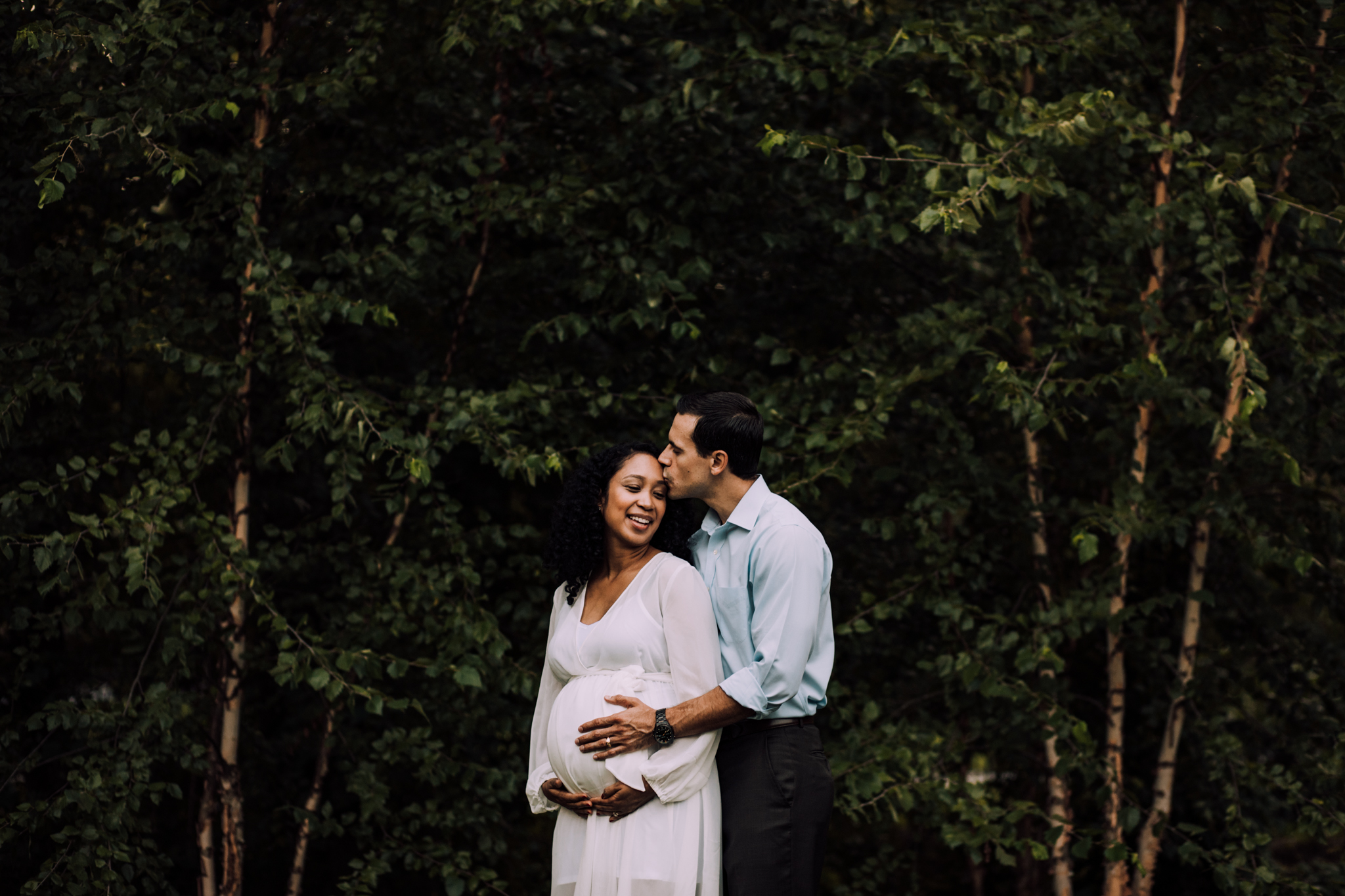 Man kissing pregnant wife in white dress by Huntsville and Madison Alabama maternity photographer Rachel K Photo