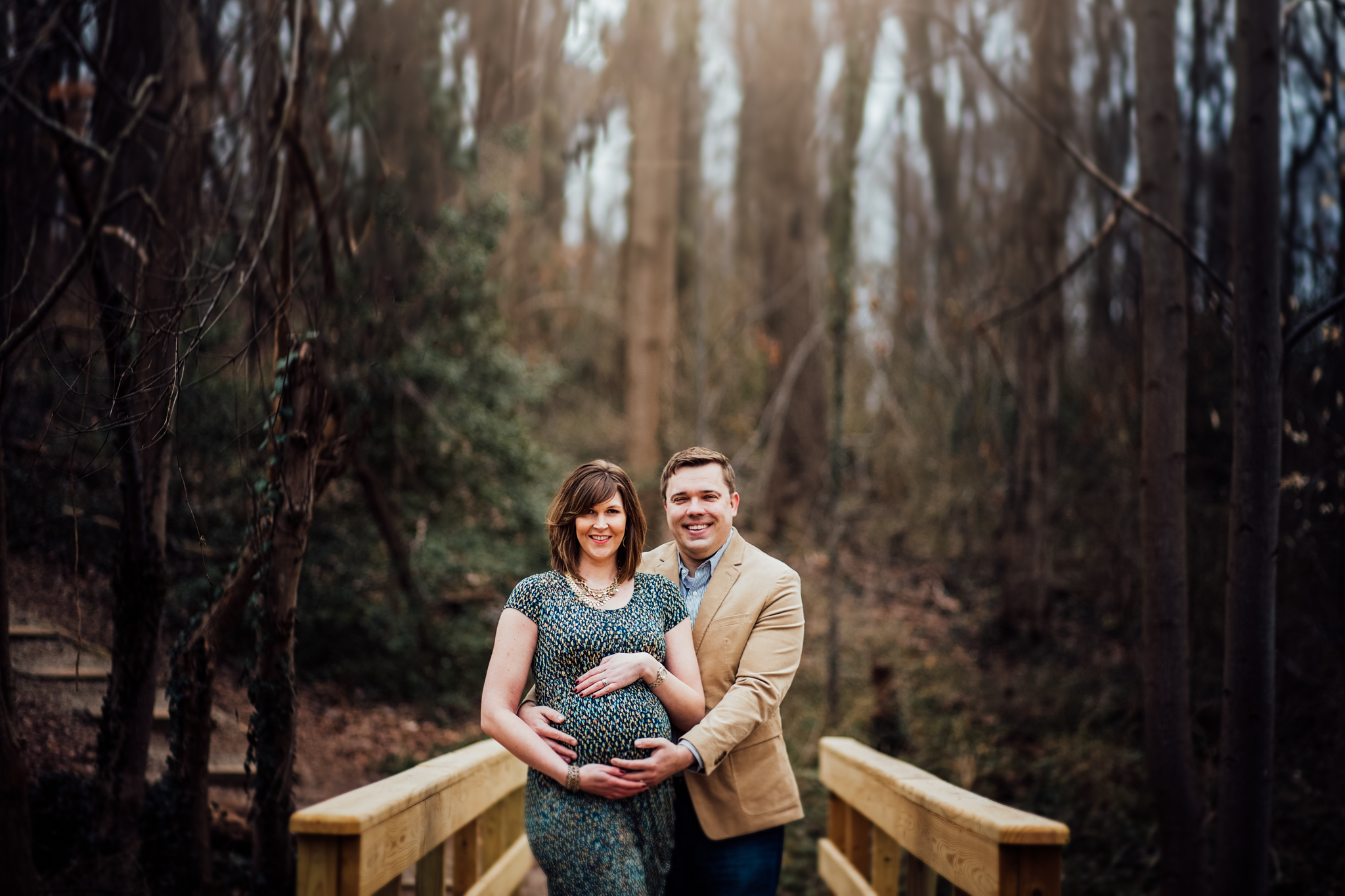 Man and pregnant woman on bridge by Huntsville and Madison Alabama maternity photographer Rachel K Photo