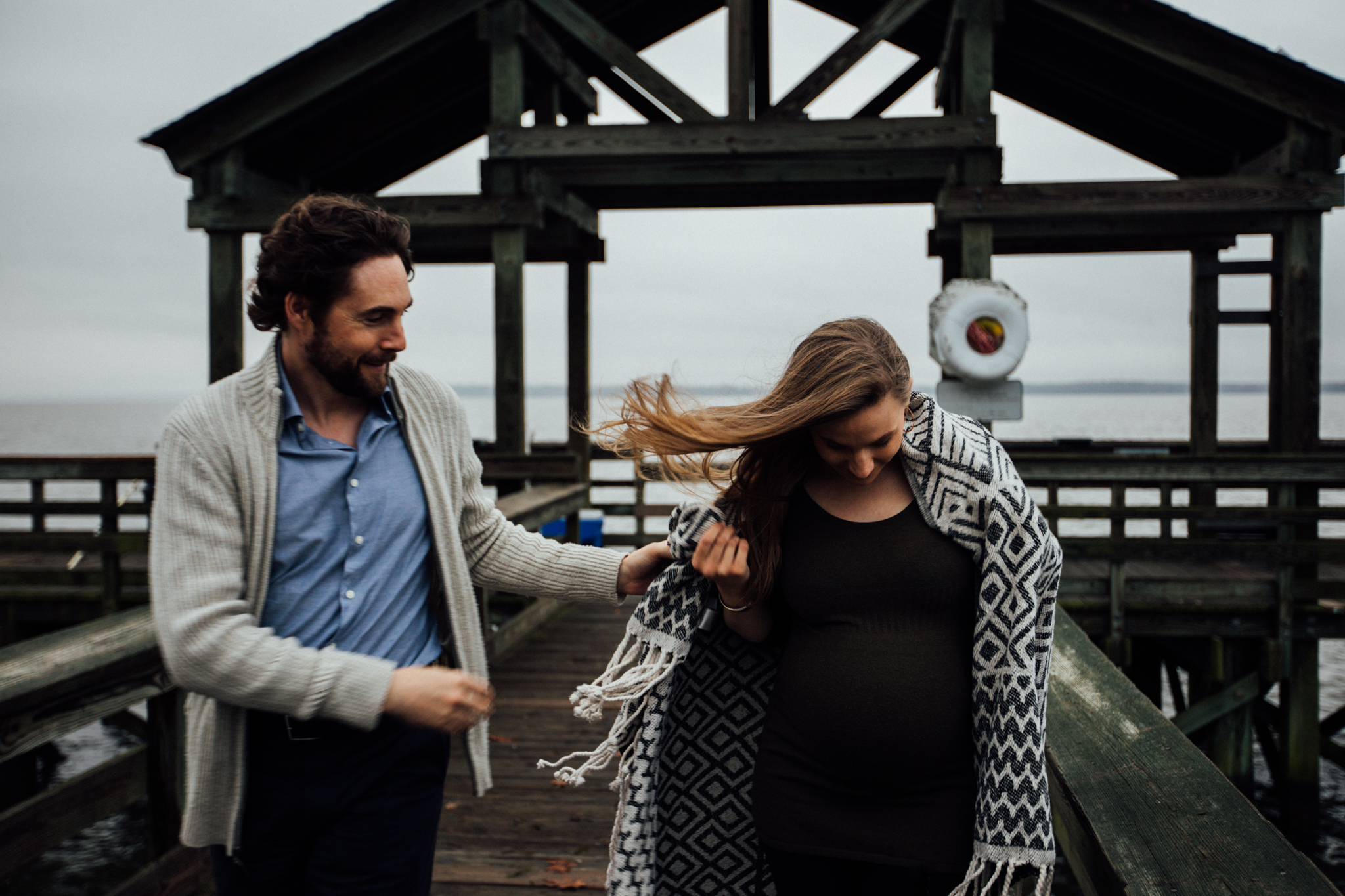 Pregnant woman with blanket on pier with man by Huntsville and Madison Alabama maternity photographer Rachel K Photo