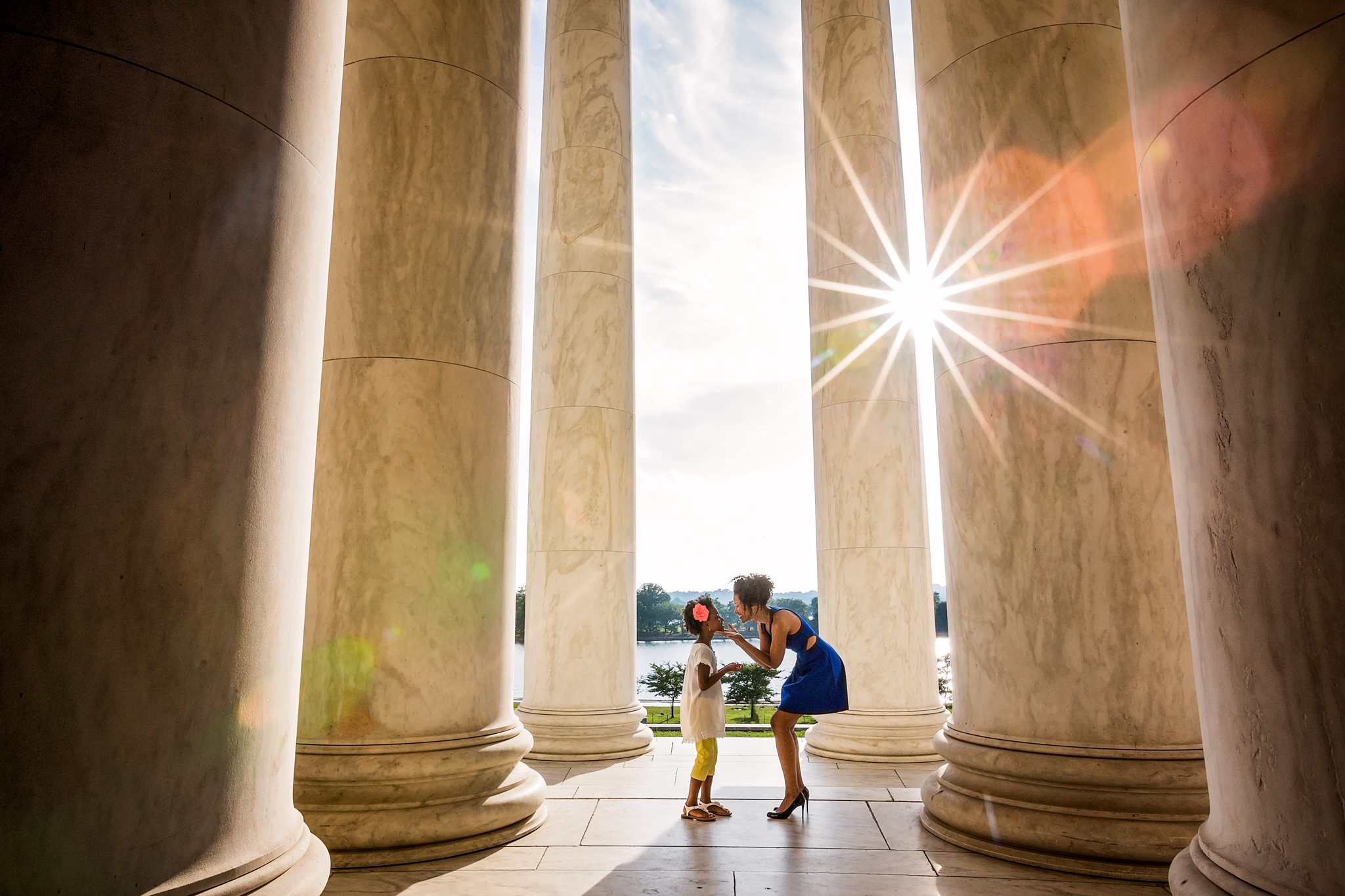 Mother and daughter at Jefferson Memorial with gorgeous sun flare.