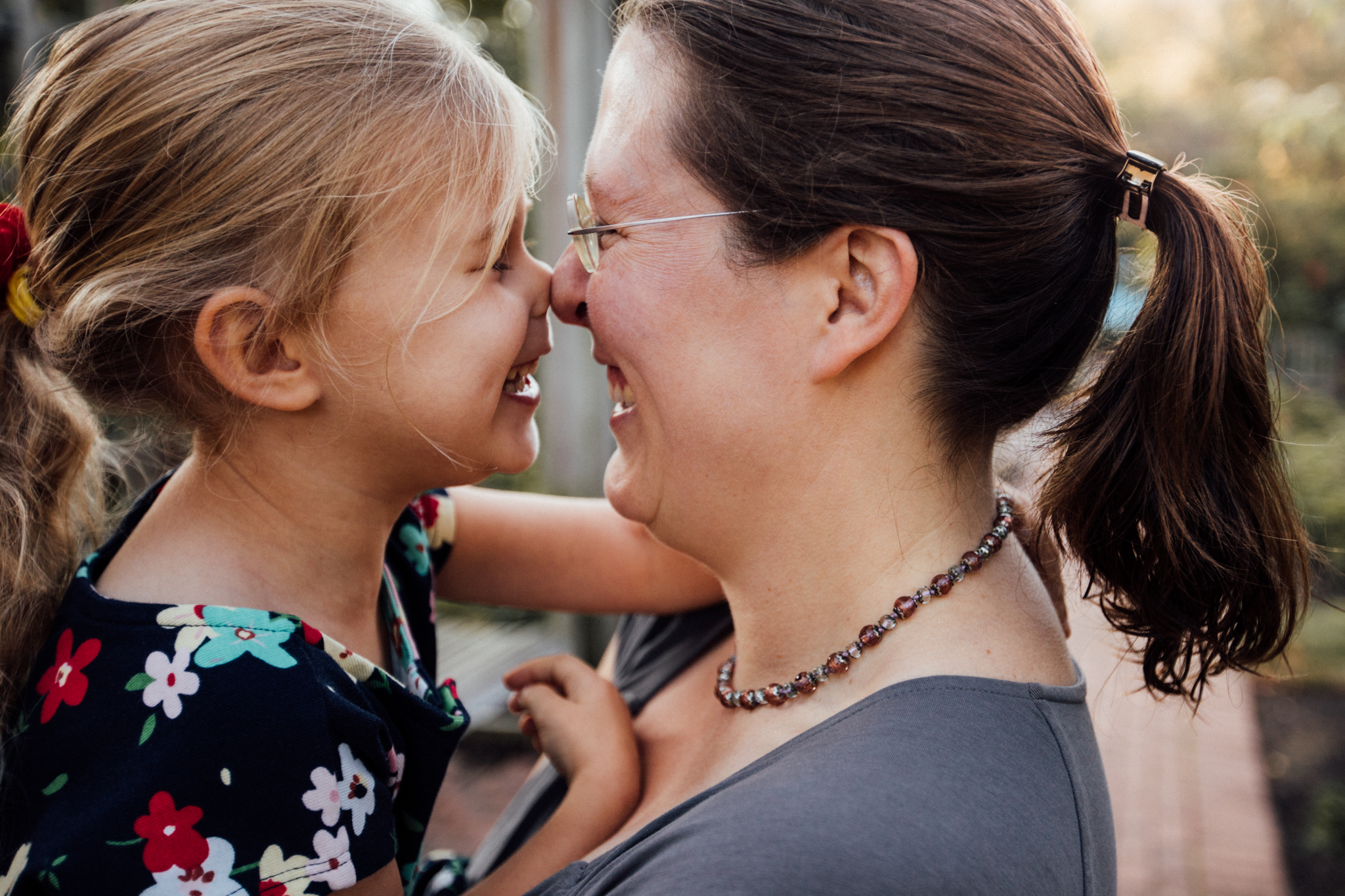 Mom and daughter rub noses by Madison and Huntsville Alabama family photographer Rachel K Photo