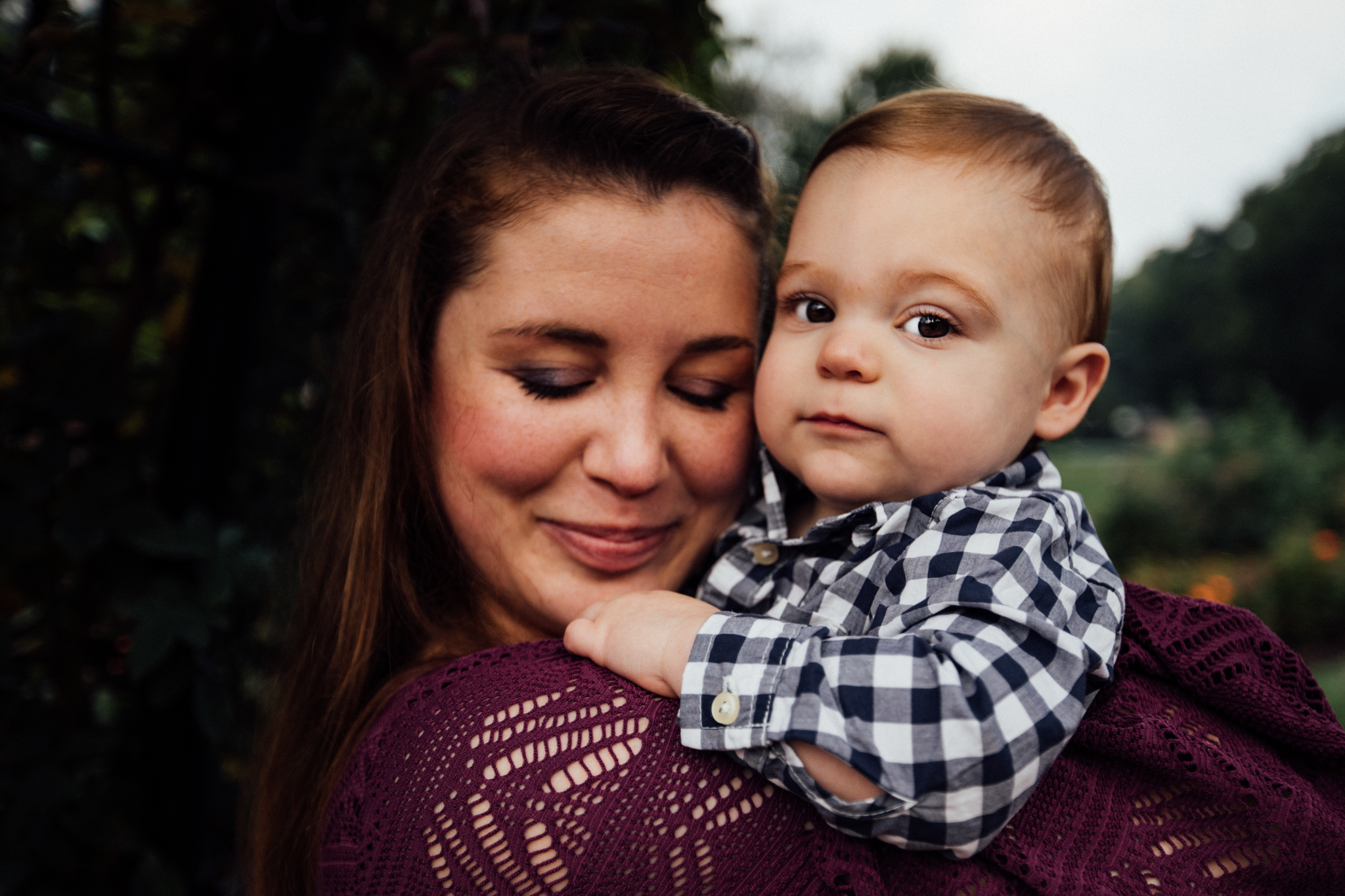 Mom snuggles toddler son by Madison and Huntsville Alabama family photographer Rachel K Photo