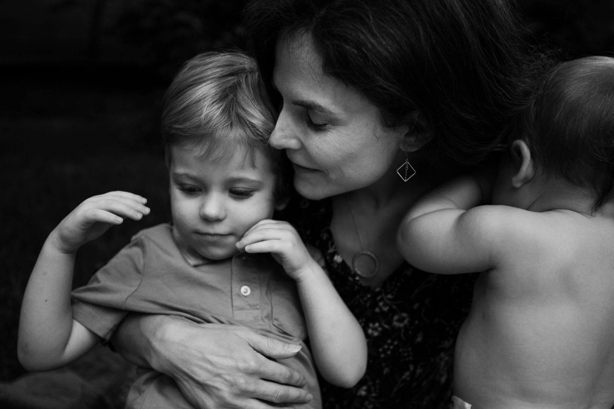 Mom snuggles toddler and baby by Madison and Huntsville Alabama family photographer Rachel K Photo