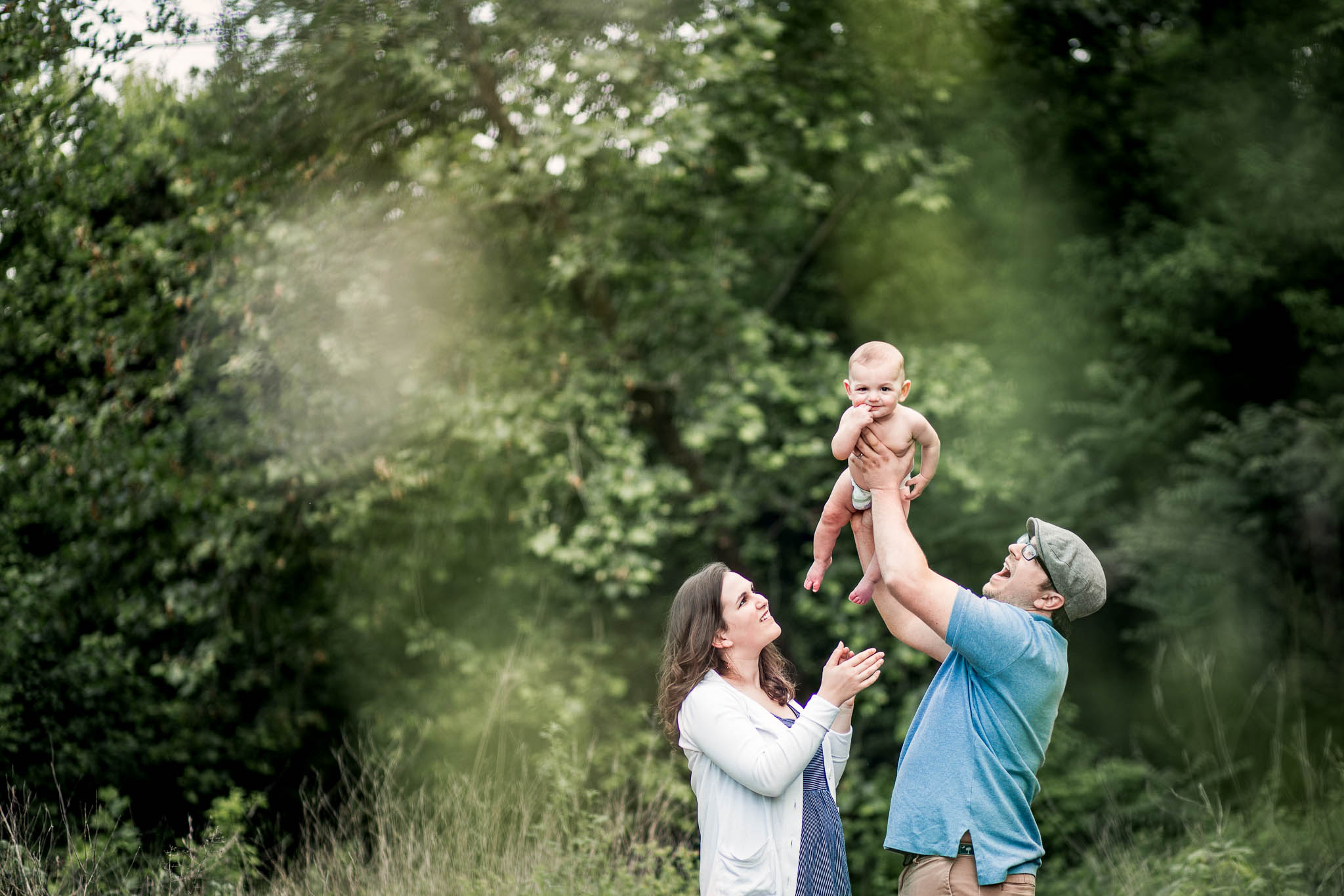 Father holds baby in the air by Madison and Huntsville Alabama family photographer Rachel K Photo