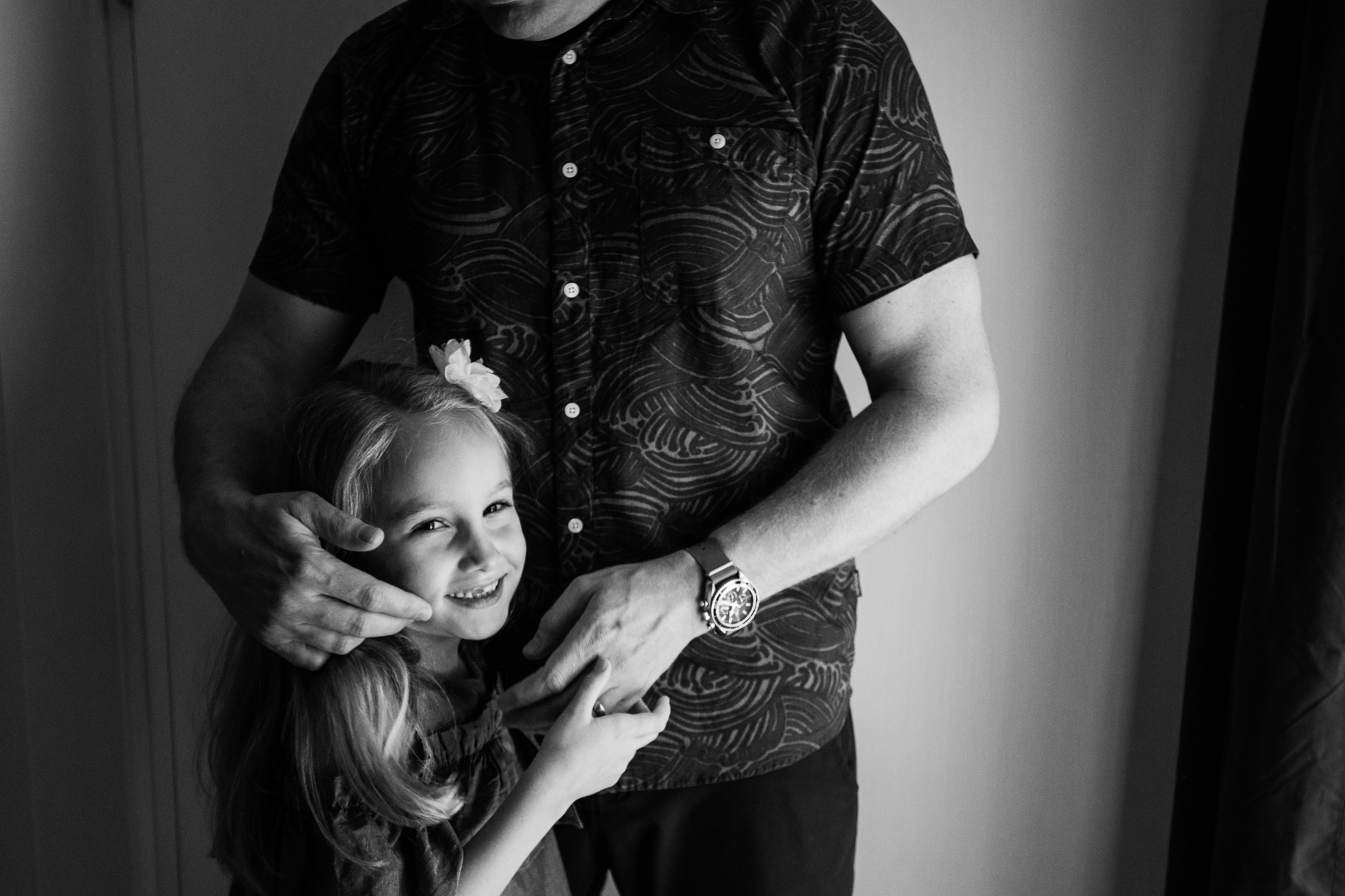 Father brushes daughter's hair back by Madison and Huntsville Alabama family photographer Rachel K Photo