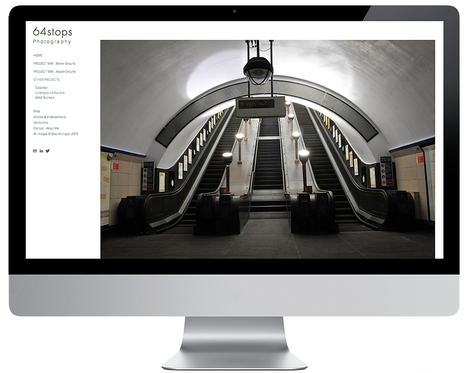computer screen with website page of London Underground escalator at night