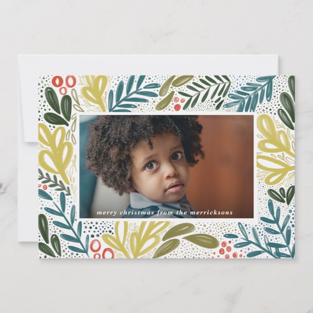 Something about the colors of this hand drawn frame of foliage feels so fresh and new while the whimsical strokes give it a cheerful and lighthearted feel. This holiday card seems like the kind you'd find in a hip, scandinavian-bohemian home full of natural wood, white walls and lots of plants.   Bramble by MontgomeryFest
